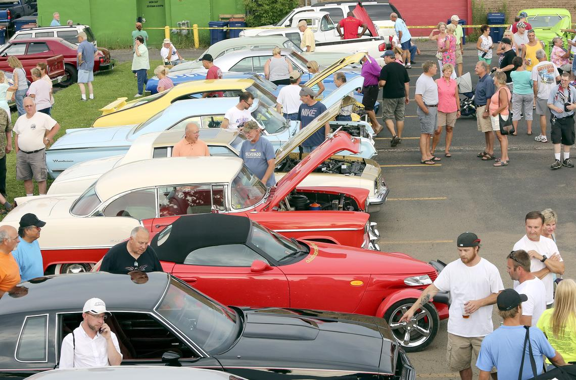 People check out cars at the Kyle Smalley Memorial Car Show in 2016. The event is part of Spirit Valley Days. (file / News Tribune)