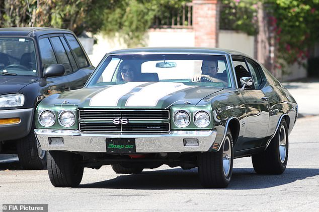 Riding shotgun: Metcalfe's date was all smiles when they rumbled their way to and from the deli in his classic muscle car