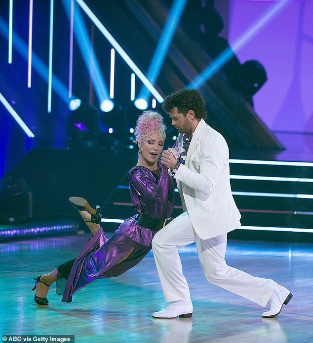 'A' for effort: Metcalfe and pro dance partner Sharna Burgess were eliminated from DWTS after performing a tango during '80s Night on Monday