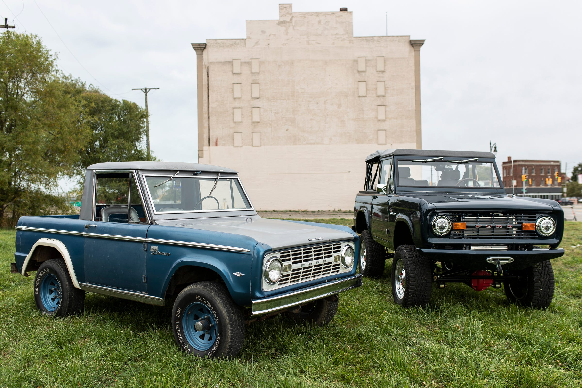 The 1966 Ford Bronco with a VIN number of 000, left, and Gateway Bronco's re-imagined edition that costs about $320,000. This original 1966 Bronco is the first Bronco ever to roll off the Ford production line. It was given to race car driver Carroll Shelby by Ford Motor Co. These images were taken in Detroit on Wednesday.