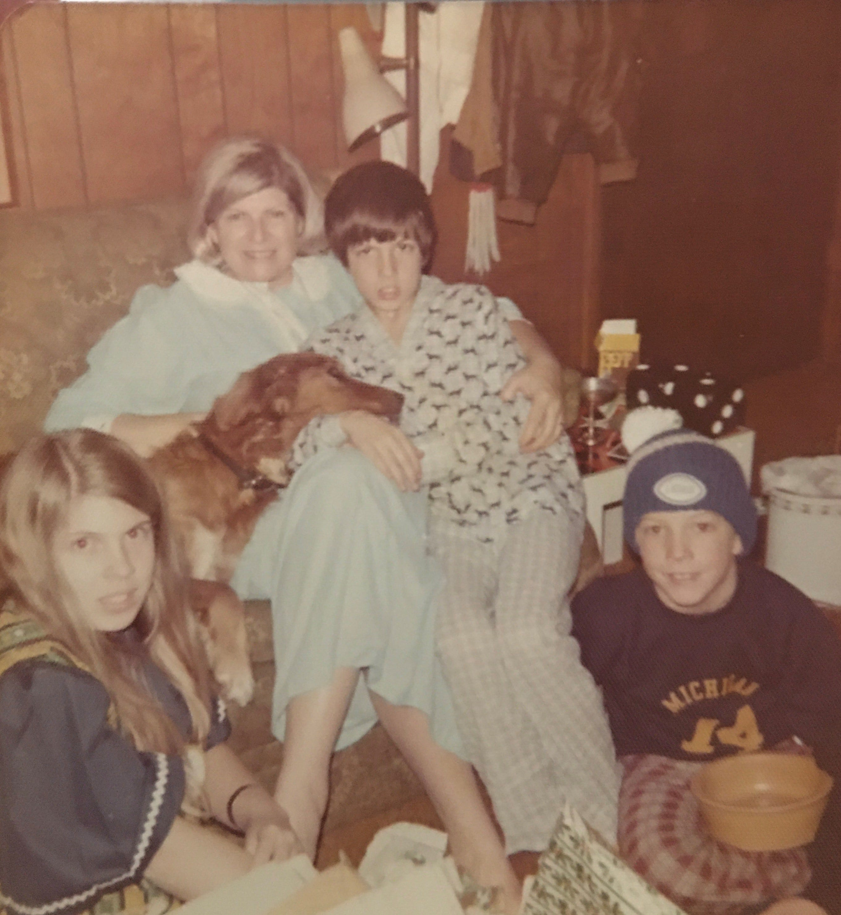 From left, Maura Tracey, dog Tara, Joan Tracey, Lawrence Tracey and Sean Tracey in their home in Lathrup Village circa 1974. Sean Tracey grew up to become a Houston trial lawyer and comes home for summers in Michigan.