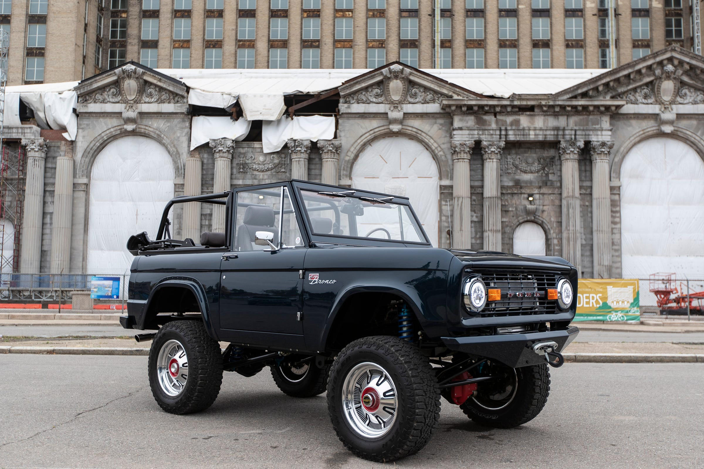 """This 1968 re-imagined Ford Bronco is owned by Sean Tracey of Houston, in front of Michigan Central Station in Detroit. Tracey essentially had Gateway Bronco rebuild it from scratch """"engineering out all the 50-year-old problems."""""""