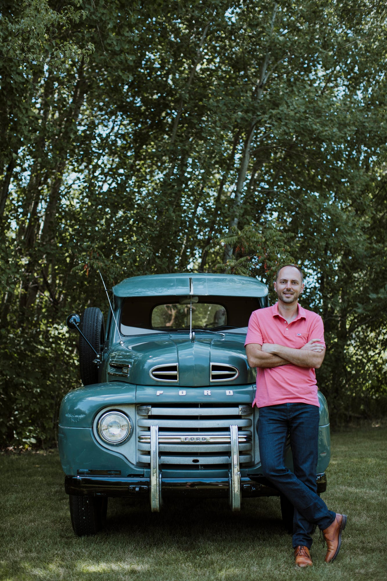 Jonathan Klinger, vice president of car culture at Hagerty, the world's largest insurer of collector vehicles, is pictured at his home in Traverse City in July with his unrestored 1950 Ford F3.