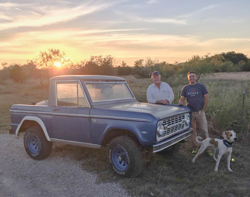 Vinnie Yakubanski, left, and Seth Burgett with his dog, Bronco, meet on Hell's Gate Loop in Strawn, Texas, just after closing the sale of the first Ford Bronco built, with VIN 000 in October 2016. Yakubanski declined to disclose the sale price.