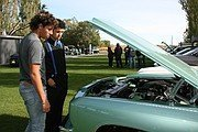 Car enthusiasts gather for show near end of strange year