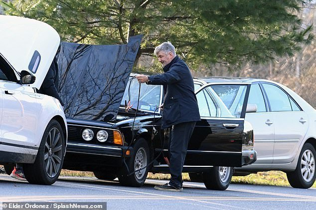 Working: Baldwin popped open the hood of the car and broke out jumper cables for the occasion