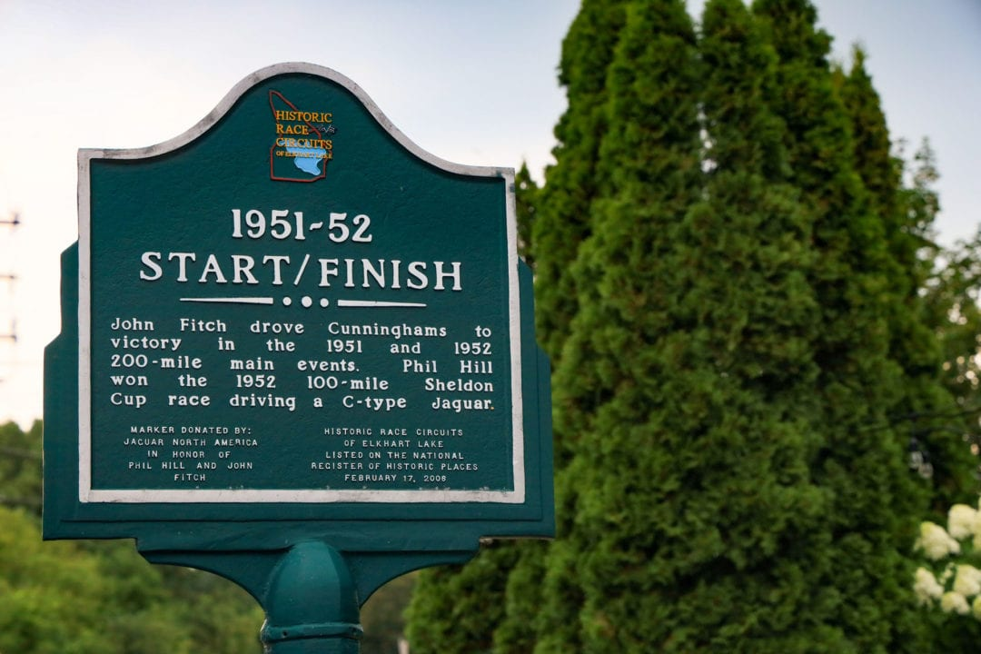 """A green historic marker that reads """"Start/Finish"""""""