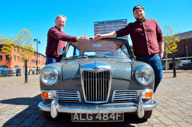 The Riley Cars Heritage Trust, incorporating the Riley Archive, hands over a Riley Elf to a new driver as part of the Classic Car Loan Scheme. Pictured is the recipient Joe Dawson (right), 30, with Andrew Gray, 65, of the Riley Cars Archive Heritage Trust