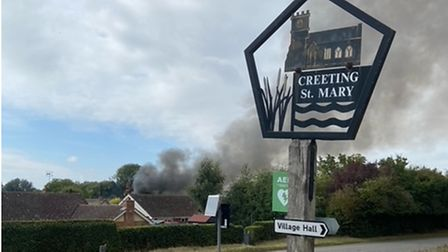 Fire crews were first called to the scene in Creeting St Maryby a police officer who spotted the smoke