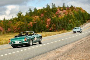 Matt Bartlett in his 1973 MGB, and Hilary Riem in her father Justin's 1966 Ford Mustang